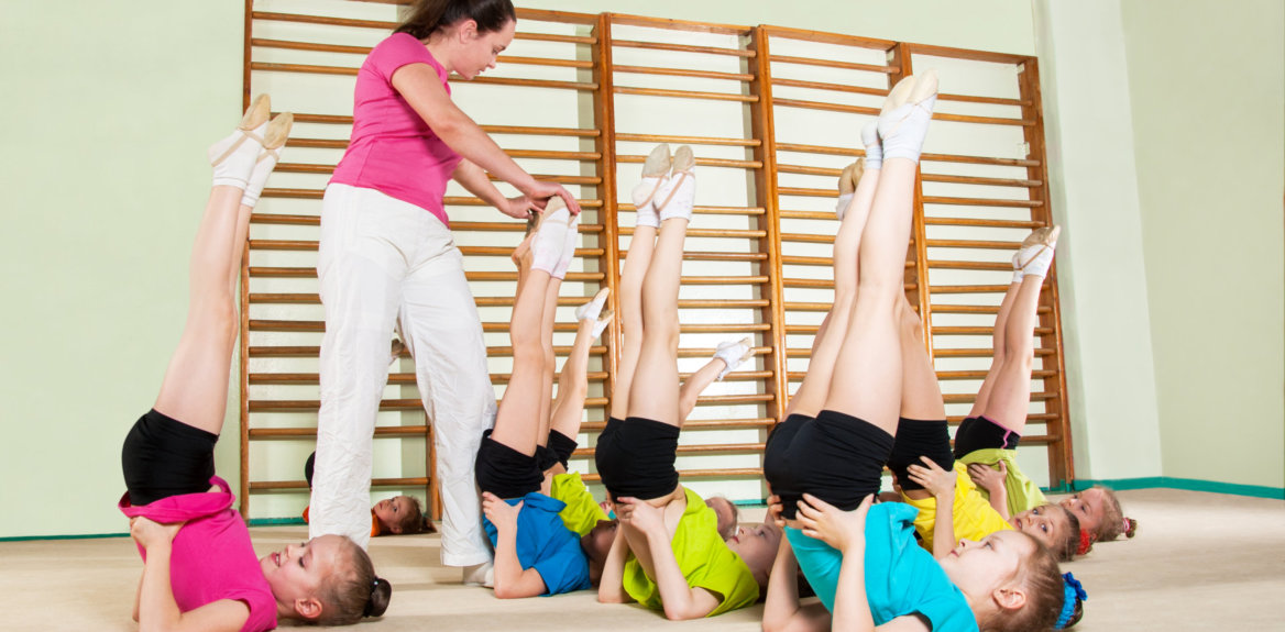 teacher and kids having exercise discussion